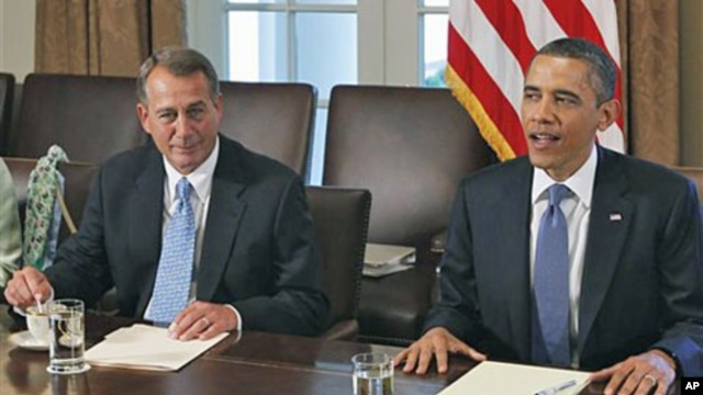 President Barack Obama sits with House Speaker John Boehner of Ohio, as he meets with Republican and Democratic leaders regarding the debt ceiling, in the Cabinet Room of the White House in Washington, DC,  July 11, 2011