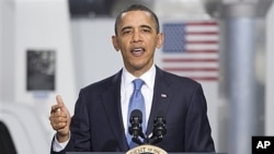 President Barack Obama gestures while speaking at a UPS facility in Landover, Maryland, April 1, 2011