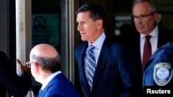 FILE - Former U.S. national security adviser Michael Flynn leaves U.S. District Court, where pleaded guilty of lying to the FBI about his contacts with Russia's ambassador to the United States, in Washington, Dec. 1, 2017.