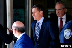 FILE - Former U.S. National Security Adviser Michael Flynn departs U.S. District Court, where he pleaded guilty to lying to the FBI about his contacts with Russia's ambassador to the United States, in Washington, Dec. 1, 2017.