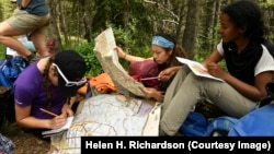 Molly Hancock, left, Yareli Herrera, middle and Taliyah Emory-Muhammad, right, learn how to read a paper map with other girls along the Gore Range Trail near Frisco, Colo. The girls are taking part in a new program called Girls on Rock. (Helen H. Richardson/The Denver Post)