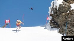 FILE - A TV drone flies beside Canada's Erick Guay during the second practice of the men's Alpine skiing World Cup downhill race at the Lauberhorn in Wengen, January 12, 2012.