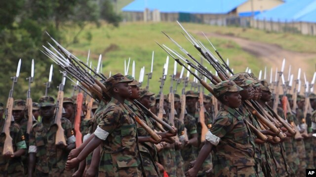 Somali government soldiers trained by the European Union Training Mission team march during their passing out ceremony at Bihanga army training camp, 368 km (230 miles) west of Kampala, February 1, 2013.