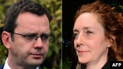 FILE - This combination of file pictures shows (L) former News of the World editor, Andy Coulson, and (R) former News International chief executive Rebekah Brooks.