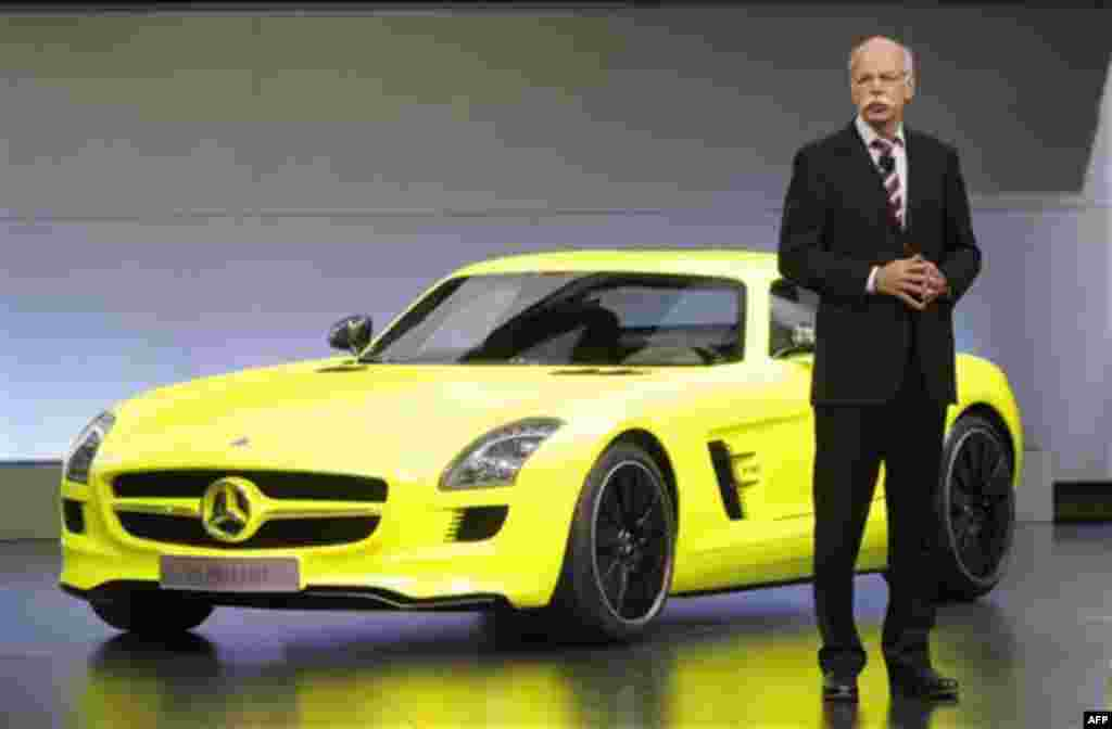 Dieter Zetsche, Chairman of the Board of Management of Daimler AG and Head of Mercedes-Benz Cars introduces the Mercedes Benz SLS AMG E-Cell at the North American International Auto Show in Detroit, Monday, Jan. 10, 2011. (AP Photo/Paul Sancya)