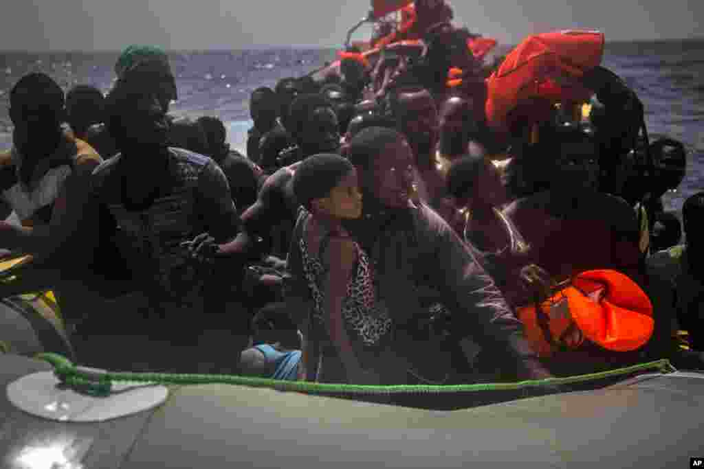 Migrants wait to be rescued by aid workers of Spanish NGO Proactiva Open Arms in the Mediterranean Sea, about 15 miles north of Sabratha, Libya.