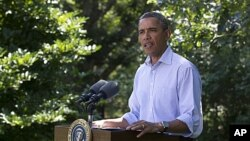 President Barack Obama speaks about Hurricane Irene in Chilmark, Mass. on Martha's Vineyard on Friday, Aug. 26, 2011