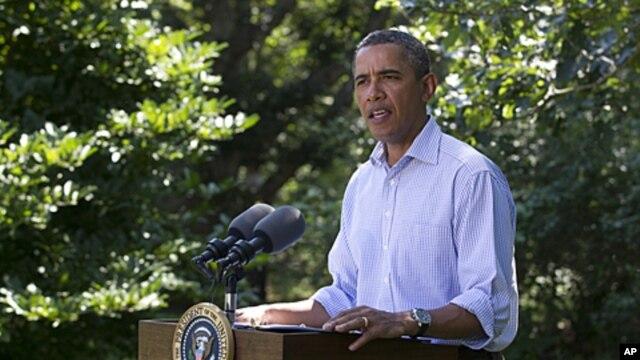 President Barack Obama speaks about Hurricane Irene in Chilmark, Mass. on Martha's Vineyard on Friday, Aug. 26, 2011