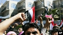Opposition supporters shout slogans during an anti-government protest in Sana'a, February 3, 2011