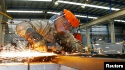 A laborer works at the Gottert machinery and tools plant factory in Garin, Argentina, May 20, 2016.