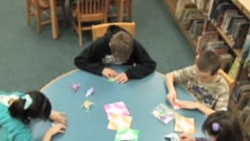 Students making paper cranes at Somerville Elementary School in Ridgewood, New Jersey
