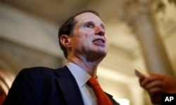 FILE - Sen. Ron Wyden speaks to reporters after leaving the Senate on Capitol Hill in Washington, D.C., in April 2011.