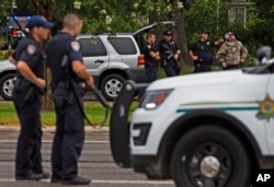 Law enforcement officers man a road block after police officers were shot in Baton Rouge, Louisiana, July 17, 2016.