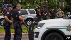 Law enforcement officers man a road block after police officers were shot earlier in the day in Baton Rouge, Louisiana, July 17, 2016. Multiple law enforcement officers were killed and wounded Sunday morning in a shooting near a gas station in Baton Rouge