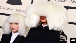 Sia, right, and Maddie Ziegler arrive at the 57th annual Grammy Awards at the Staples Center in Los Angeles, California, Feb. 8, 2015.