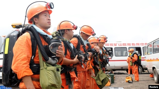 Emergency workers prepare for an attempt to rescue 27 people trapped in a coal mine in east China's Anhui province Aug. 19, 2014.