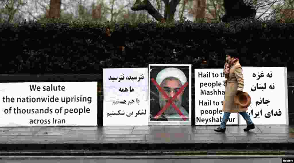 Opponents of Iranian President Hassan Rouhani hold a protest outside the Iranian embassy in west London, Britain, Jan. 2, 2018.