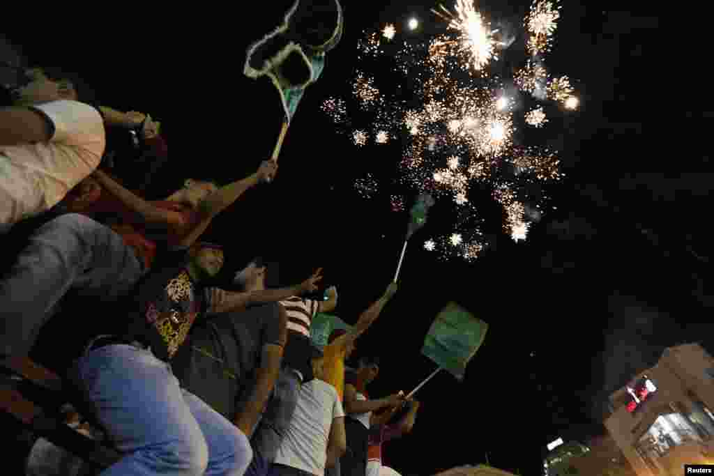 Palestinians release fireworks to celebrate the ceasefire, in the West Bank city of Ramallah, Aug. 26, 2014.