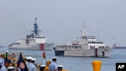 The U.S. Coast Guard National Security Cutter Bertholf (WMSL 750), left, and the Philippine Coast Guard ship BRP Batangas arrive Wednesday, May 15, 2019 in Manila, Philippines, after taking part in a joint exercise off the South China Sea. Capt…