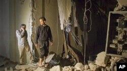 卡扎菲講話時電視臺附近被炸