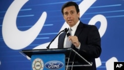 Ford President and CEO Mark Fields addresses the Flat Rock Assembly Tuesday, in Flat Rock, Michigan. Ford is canceling plans to build a new $1.6 billion factory in Mexico and will invest $700 million in a Michigan plant.
