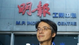 Former Ming Pao chief editor Ken Lau is pictured outside his office in Hong Kong on Jan. 31, 2014.