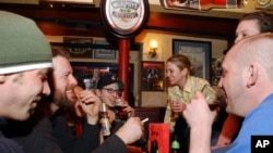 University students enjoy a few beers at a pub in Cambridge, Mass. in this file photo.