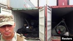 Ảnh minh họa: Hai container chứa vũ khí bị tịch thu của Bắc Hàn tại thành phố Colon, Panama, ngày 17/7/2013.