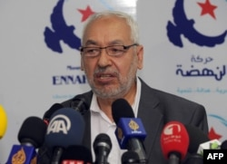 Tunisian al Nahda party leader Rached al Ghannouchi speaks during a press conference on May 15, 2013 in Tunis.