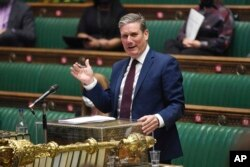 In this handout photo provided by UK Parliament, Labour Party leader Keir Starmer speaks during Prime Minister's Questions at the House of Commons, London, June 9, 2021.