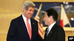 U.S. Secretary of Sate John Kerry, left, is greeted by Japanese Foreign Minister Fumio Kishida prior to their meeting at Foreign Ministry's Iikura Guesthouse in Tokyo, April 14, 2013.
