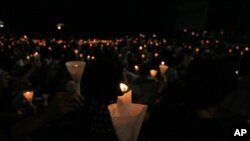 Candles light up hope