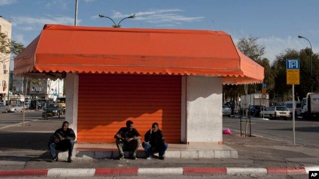 African migrants sit in a street in southern Tel Aviv, Israel, Jan. 10, 2012.