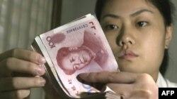 Trung Quốc bị cáo buộc cố tình hạ thấp giá trị đồng nguyên để dành cho các công ty Trung Quốc lợi thế bất công đối với các nhà sản xuất tại Hoa Kỳ