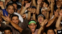 Supporters of ousted Egypt's President Mohammed Morsi shout slogans during a demonstration after the Iftar prayer, evening meal when Muslims break their fast during the Islamic month of Ramadan, in Nasr City, Cairo, Egypt, July 10, 2013.