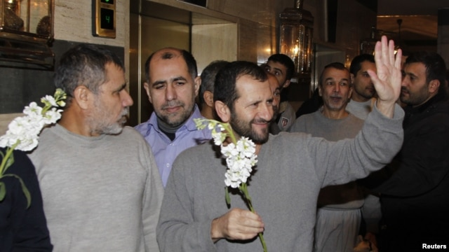 Iranians released by Syrian rebels arrive at a hotel in Damascus, January 9, 2013.