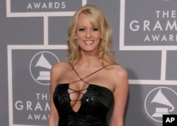 FILE -Stephanie Clifford, known as Stormy Daniels, arrives for the 49th Annual Grammy Awards in Los Angeles, Feb. 11, 2007.