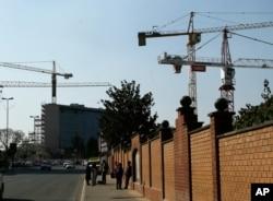 FILE - Construction cranes tower over the Rosebank suburb of Johannesburg, South Africa, Sept. 4, 2018.