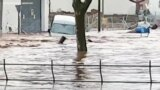 Video Shows Car Being Swept Away by Floodwaters in Spain