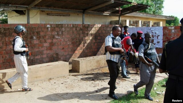 Security officers patrol the Kano State Polytechnic campus in northern Nigeria, where a female suicide bomber blew herself up, July 30, 2014.
