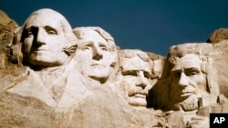 The Mount Rushmore monument is shown in South Dakota. From left are George Washington, Thomas Jefferson, Teddy Roosevelt and Abraham Lincoln.