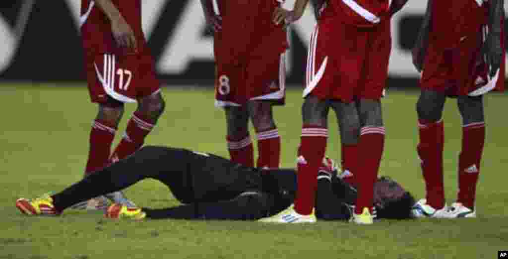 "Sudan's goalkeeper Akram El Hadi Salim lies on the ground after sustaining an injuring during their African Nations Cup Group B soccer match against Burkina Faso at Estadio de Bata ""Bata Stadium"", in Bata January 30, 2012."