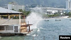 Waves pound the beach in Acapulco as Hurricane Odile churns far off shore September 14, 2014.
