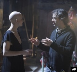 "DELPHINE CHANEAC as Dren and director VINCENZO NATALI on the set of Warner Bros. Pictures' and Dark Castle Entertainment's science fiction thriller ""SPLICE,"" a Warner Bros. Pictures release."