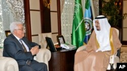 Palestinian President Mahmoud Abbas, left, meets with Saudi Arabia's Crown Prince Salman bin Abdulaziz in Jeddah, Saudi Arabia, Wednesday, June 18, 2014. Abbas said his forces are helping in the search for three Israeli teens missing in the West Bank.