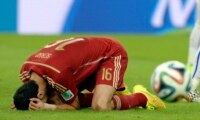 The agony of defeat for Spain.
