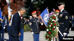 U.S. President Barack Obama lays a wreath at the Tomb of the Unknowns on Veterans Day at Arlington National Cemetery in Washington on November 11, 2013.