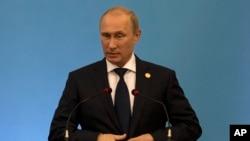 Russia's President Vladimir Putin speaks during the BRICS 2014 summit in Fortaleza, Brazil, July 15, 2014.