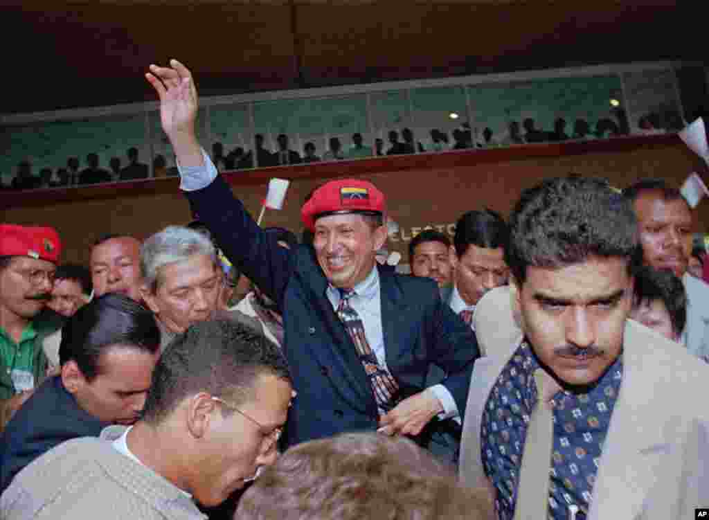 Chavez waves to the crowd after announcing his candidacy for the presidency in downtown Caracas Plaza, Venezuela, July 29, 1997.