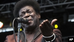 FILE - Soul singer Charles Bradley performs at the Shaky Knees Music Festival in Atlanta, Ga., May 9, 2014. His publicist said Bradley died Saturday after a battle with stomach cancer.